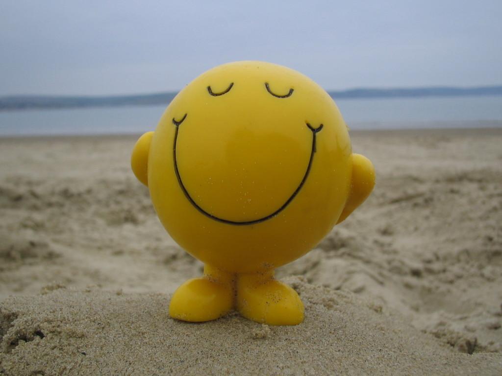 smile face on a beach