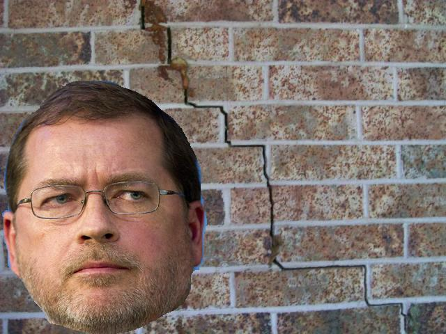 cracked-brick-wall-with-norquist-head